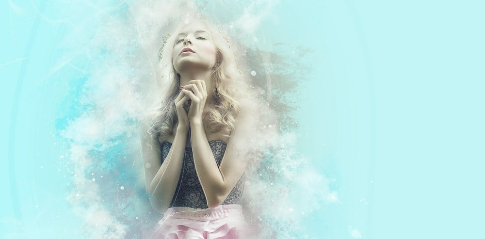 woman praying with energy coming off and aqua background