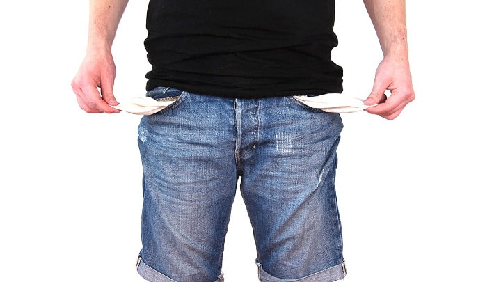 man with shorts emptying his pockets need law of attraction money help