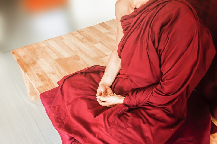 monk doing zen mediation with cosmic mudra